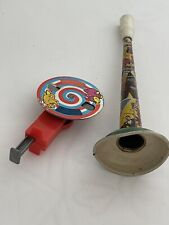 Vintage Spark toy and a Tin Horn noise maker