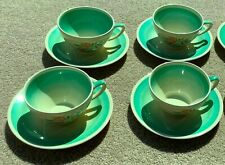 FOUR TEACUPS & SAUCERS BY SUSIE COOPER IN GREEN DRESDEN SPRAY, KESTREL SHAPE