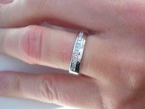 Diamond Wedding Ring. Princess-cut diamonds. Size K1/2 18ct White Gold. Report