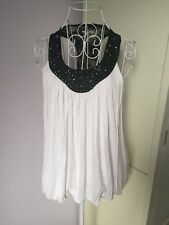 Women's vest top. Beaded neckline, lace effect racer back. Size 8.