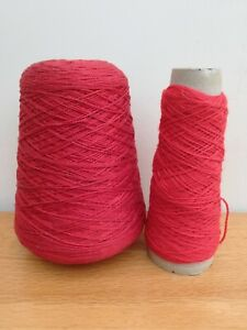 Machine knitting wool red 2 cones partly used.