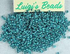 11/0 Round Toho Glass Seed Beads #377- Lt. Sapphire/Metallic Teal Lined 10 grams