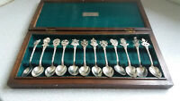 LOVELY VINTAGE CASED SET 12  MALAYSIA WHITE METAL / PLATED/ SILVER TEASPOONS