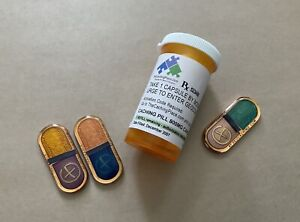 The Caching Pill 3 Piece Geocoin Set / ACTIVATED, ADOPTABLE