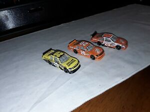nascar diecast 1 64 lot loose.A small lot of Joey's JGR #20 COT & nationwide car