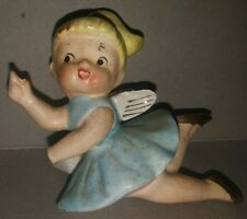 Rare Porcelain girl with wings and small napkin ring on the back  made in japan