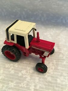 Ertl metal die cast International tractor 1086 with white cab.  1/64 scale Wide