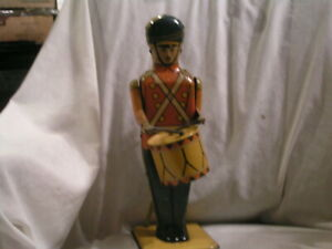 VINTAGE NUMBER 27 WOLVERINE MADE DRUM MAJOR WIND UP TOY