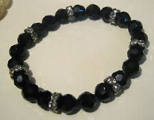 Very pretty faceted black beaded bracelet with silver tone plastic spacers