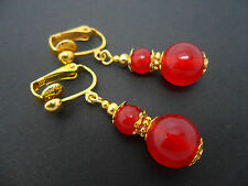 A PAIR OF RED CARNELIAN  GOLD PLATED DROP DANGLY CLIP ON EARRINGS. NEW.