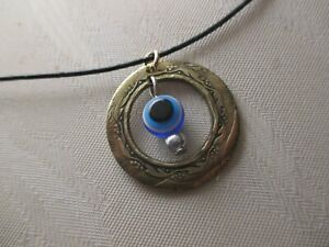 Inside Out Coin pendant with amulet eye