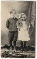 050221 VINTAGE RPPC CHILDREN REAL PHOTO POSTCARD BOY IN SHORT PANTS GIRL W/ BOW