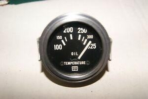 "Stewart Warner vintage gauge 2 1/16"" electric 12 Volt oil temperature looks NOS"