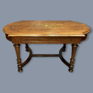 Antique French walnut coffee table with brass marquetry inlay