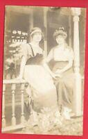 RPPC TWO WOMEN SITTING ON PORCH FANCY HATS POSTCARD