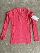 NWT Lululemon Rest Less Pullover Size 4 Coral Pink Run Long Sleeve Stretch