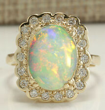 2.95 Carat Natural Opal 18K Yellow Gold Diamond Ring