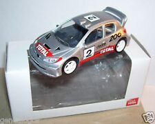 NOREV 3 INCHES 1/64 PEUGEOT 206 WRC N°2 CLARION TOTAL RALLYE 300 CV 220 KM/H BOX