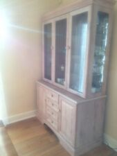 A beautiful, glass fronted highboard with lots of storage for the dining room!