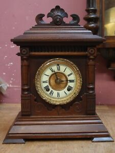 ANTIQUE WALNUT CASED MANTLE CLOCK with AMERICAN ANSONIA MOVEMENT