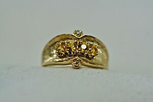 VINTAGE 14K Y GOLD RING WITH 4, 3.10 MM YELLOW SAPPHIRES and 2 dias.