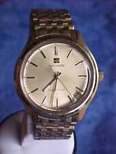 OUTSTANDING 1970'S MOVADO TUNING FORK ELECTRONIC GOLD DATE MENS WRIST WATCH