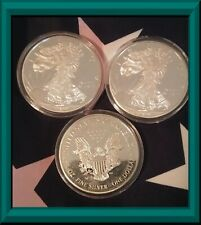 Silver Eagle Clad One Dollar Coins (Lot of 3)
