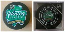 2019 NHL WINTER CLASSIC GENERIC & CUBED PUCK COMBO TWO (2) BRUINS BLACKHAWKS