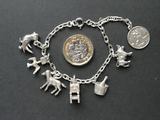 Vintage Silver charm bracelet with 7 charms