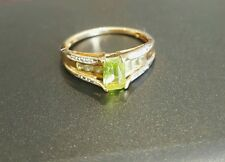 9ct Solid Yellow Gold Peridot Ring with tiny diamonds.