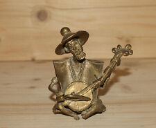 Vintage hand made bronze figurine African man play on banjo
