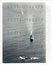 1969 US Navy Jet Flies Over Russian Ship & Subs Bound For Cuba Press Photo
