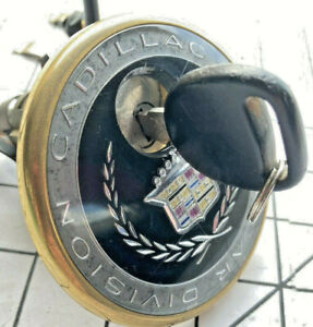 94-99 Cadilllac Deville Seville trunk lock cover with key and bracket
