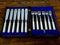 BOXED SET OF 6 FISH KNIVES AND FORKS EPNS AND FAUX BONE HANDLES
