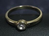 Great gold tone metal ring with small white stone size S
