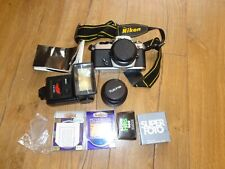 Nikon FE camera with accessories, 49mm 52mm lenses, flash and bag