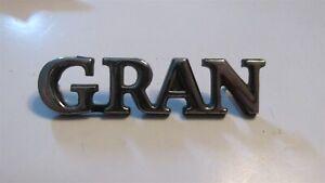 "NOS 1972 - 1976 FORD GRAN TORINO OR GRAN TORINO SPORT ""GRAN"" TRUNK DECK EMBLEM"