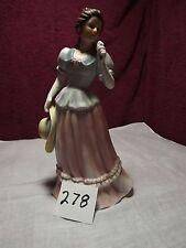 Homco figerine, woman in dress eating ice cream, #1452 8 1/2 inches tall