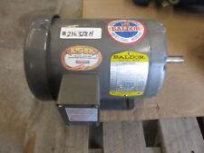 BALDOR INDUSTRIAL MOTOR #216328H 3 PHASE 1HP S/N:F199 RPM:850 60HZ USED
