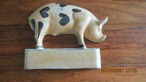 Vintage Pig door stop painted cast iron garden ornament in shape of a pig