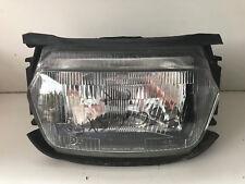 UNE OPTIQUE DE FEU PHARE AVANT HEADLIGHT LAMP MOTO SUZUKI 750 GSXF GSX-F 1991