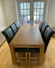 8-10 seater extending oak dining table & 6 dark brown leather chairs.