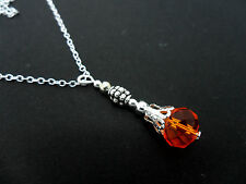 A PRETTY ORANGE  GLASS CRYSTAL NECKLACE. NEW.