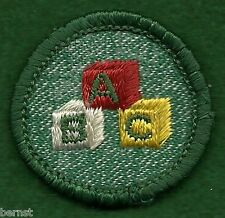 GIRL SCOUT BADGE - USED - BRIGHT MEDIUM GREEN - CHILD CARE - FREE SHIPPING