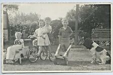 1952 PHOTOGRAPH CHILDREN WITH TOYS CYCLOPS PEDAL CAR TRICYCLE CART & DOG L130.