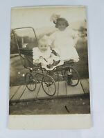 Vintage Real Photo Post Card Smiling Baby in Stroller & Girl w/Bow AZO 1910's?