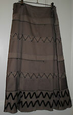 Taupe long A-line skirt with horizontal segments and beading. Liz Jordon size 10