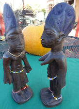 """TWO Vtg. 10"""" Wood Carved Tribal Folk Figurines Man Woman Beads Shells Dyed Hair"""