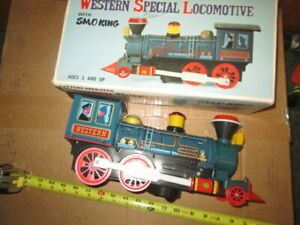 VINTAGE BATTERY OPERATED WESTERN SPECIAL LOCOMOTIVE  in box. untested.