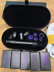 Dyson Airwrap hair straightening curling iron complete with all attachements